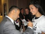 Francisco Costa signing a Fashion's Night Out tee shirt in front of his Calvin Klein store