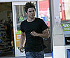Slide Photo of Zac Efron Running in a Black T-Shirt in LA