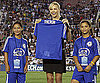 Slide Photo of Charlize Theron Holding Her Jersey at World Football Challenge Game in Pasadena