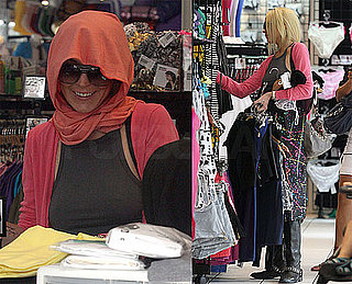 Photos of Lindsay Lohan Covering Up Her Hair While Shopping in LA