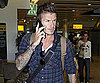 Photo Slide of David Beckham on His Phone in London