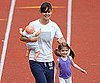 Slide Photo of Katie Holmes and Suri Cruise Running around Boston Track