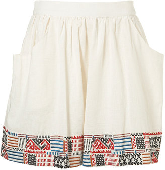 Who says you can't wear white after Labor Day? Not I. Pair this Embroidered Hem Skirt ($70) with a gray sweatshirt and short booties, and you're set.