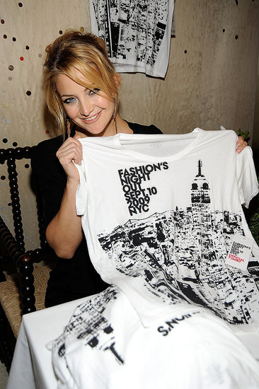 Kate shows off the event&#039;s tee