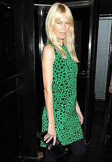 Photo of Claudia Schiffer Wearing Green Leopard Dress and Alexander McQueen Clutch at London Fashion Week