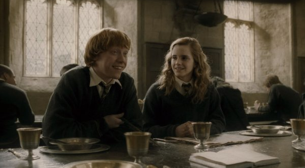 Ron and Hermione share a laugh over a meal at the Hogwarts dining hall. In the background, beautifully leaded windows stream hazy light into the space. Source