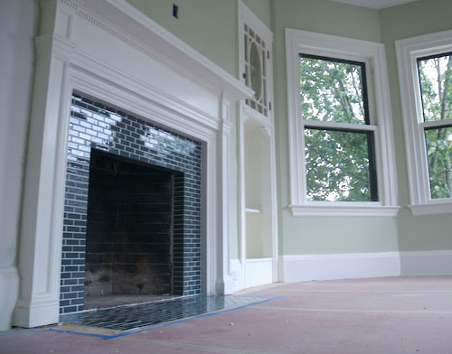 Look how gorgeous the subway tiles are on this fireplace!