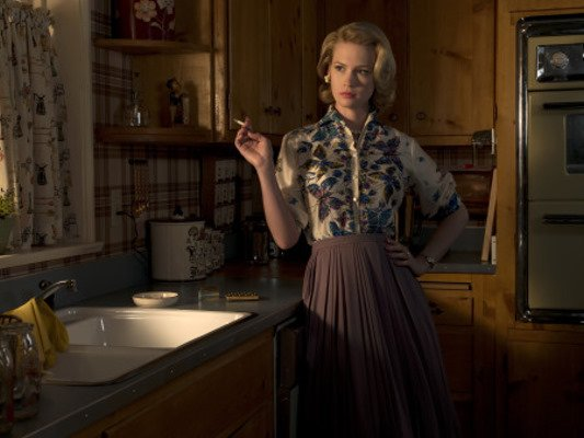 Betty Draper spends more time gossiping and smoking in her kitchen than she does cooking. While I could do without much of this room's style, I do love the curtains. I wonder, will knotty-wood cabinetry ever come back in style? Source