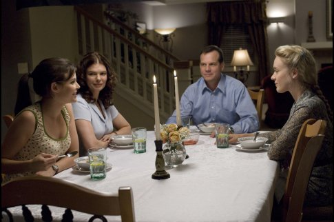 The Henricksons often eat with the entire family (with all of the kids) around the table. The dining room's traditional look reflects the family's traditional (albeit polygamous) values.  Source