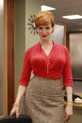 Joan Holloway's va-va-voom figure definitely dominates any space she occupies at Sterling Cooper. Still, I cant help but peek behind her at the starburst mirror. Source