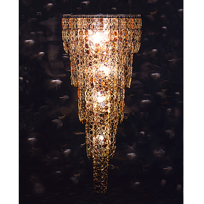 This chandelier, called Spectacle, was also made by Stuart Haygarth. It's constructed from over 1,000 pairs of prescription spectacles.  Source