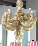 Do you have a daughter who's abandoned her army of Barbie dolls? Then do as Jonathan Adler did and create a bizarre, scalped-Barbie-effect hair chandelier. I'm kind of grossed out by this. What about you? Oh, and read more about where this chandelier was featured here. Source