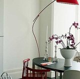 Red and white chairs and modern accessories keep this space really fresh.  Source