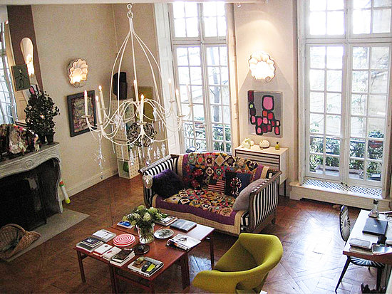 Christian Lacroix found strength in numbers by making a coffee table for his Parisian pad out of four side tables pushed together.  Source