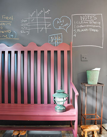 An entryway is a perfect place for a chalkboard wall. Notes, appointments, and shopping lists can be consulted before heading out the door. Source