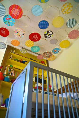 Design Dazzle adds visual interest above a crib with embroidery hoops. What a great idea!