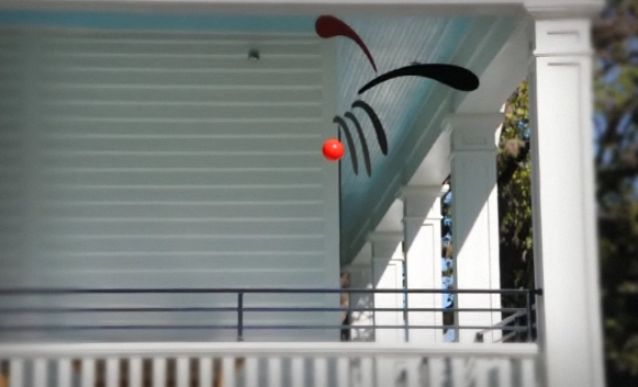 Even if you have a traditional porch, a Calder mobile will still look lovely hung from it.