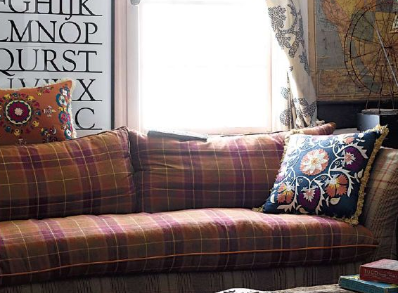 Don't be afraid to mix patterns! This buttoned-up plaid looks pretty wild when paired with suzani pillows.