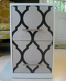 Design*Sponge has directions for turning an office file cabinet from drab to fab with a wallpaper sample.