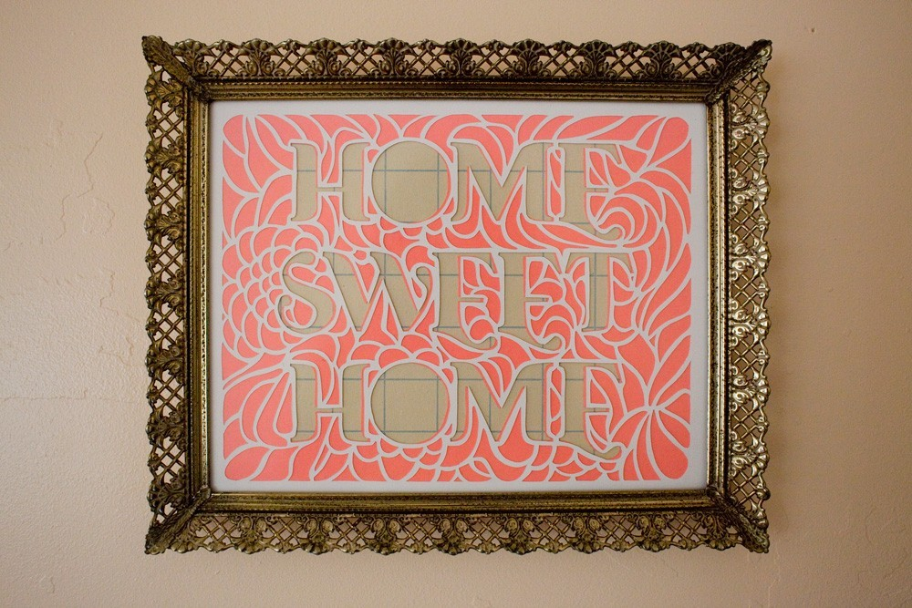 This Home Sweet Home papercut ($40) includes two layers of hand-cut paper exposing plaid below.