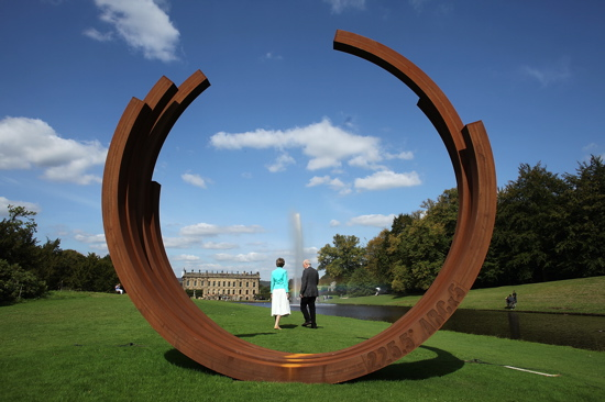 """225.5° Arc x 5"" by artist Bernar Venet adds a graceful shape to the flat garden landscape."