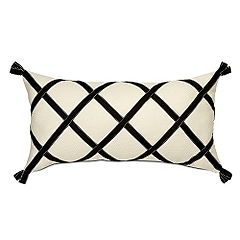 Toss a splash of criss cross work with the Auberon Crossed Ribbon Rectangular Pillow ($75) on a long sofa to recreate the look in your home.