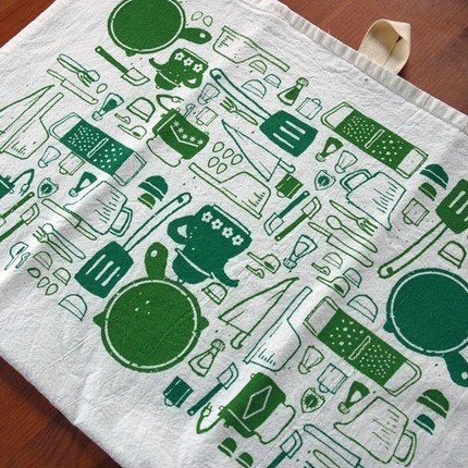 The Teapot and Toasters Tea Towel ($12) features pictures of teapots, cast iron skillet, spatulas, measuring cups, shakers, graters, and knives!