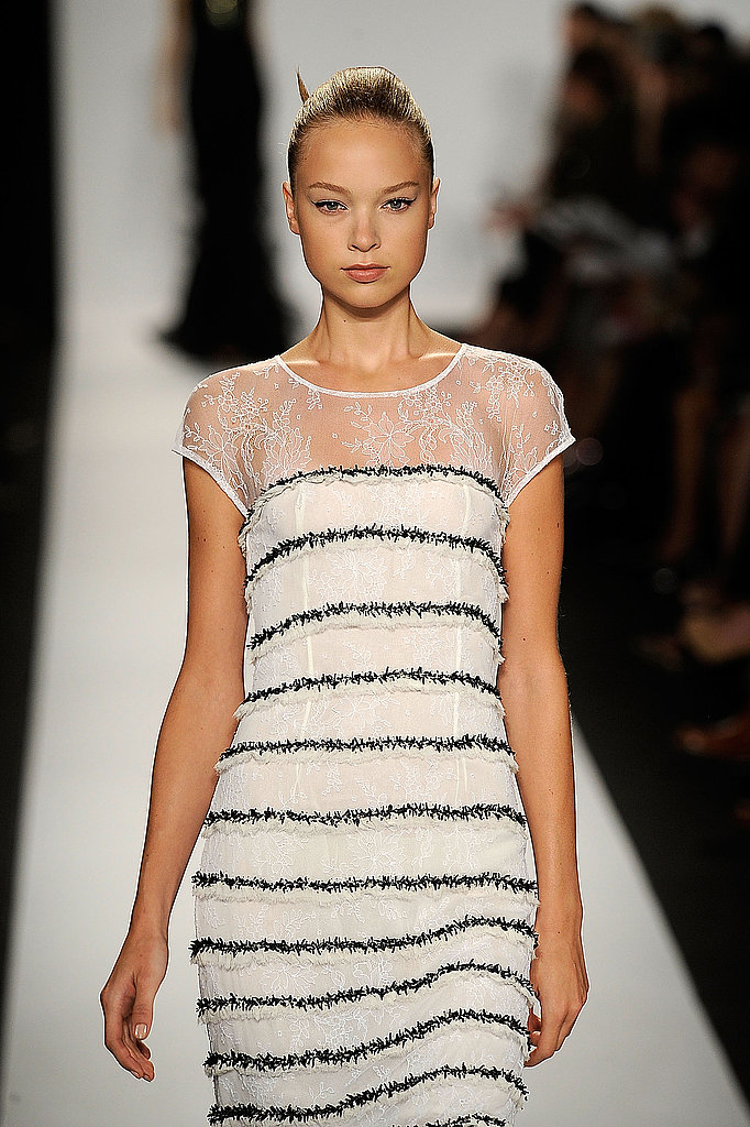 This dress's delicate, fuzzy stripes give classic black and white stripes a feminine twist.