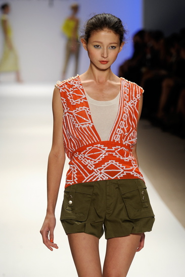 The zigzag detailing on this plunge-cut blouse gives it international flavor.
