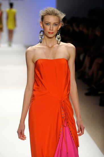 This orange and pink dress is given an edgy addition thanks to the lace-up closure on the left leg.