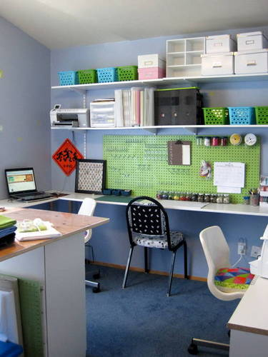 """My husband put up some pegboard for me that we spray painted green,"" explains Deanna. ""This is mostly empty right now but I plan to go through more of my scrapbooking stuff to put up here. I have lots of pegs to work with, so this will be fun."""