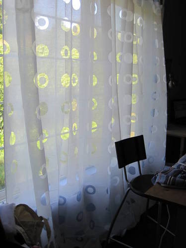 """Finally I covered my window with a polka dot sheer that I got at Ikea. It lets in tons of light, but still keeps the outside world from peeking in (this window faces the road)."""