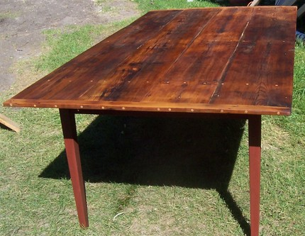 This lovely reclaimed-pine farm table ($1,050) is made entirely from lumber salvaged from a barn built in 1884.