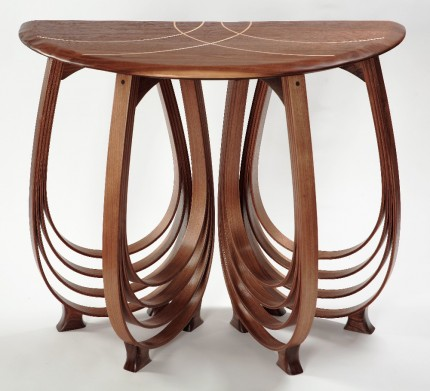 This Oceana Demilune table ($1790) is made of walnut with a graceful maple inlay, and finished in tung oil and lacquer.