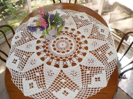 Buy your own handmade crocheted tablecloth ($65) on Etsy.