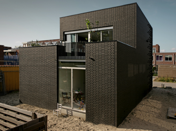 The pattern and color of this brick home is completely eye-catching.  Source