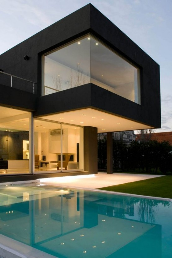 This modern, angular black house is located outside of Buenos Aires. It was designed by Andres Remy Arquitectos. Source