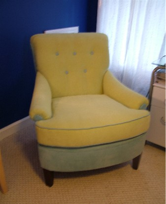 She chose light green and blue velvet fabrics and had the colors distributed in different parts of the chair. And, she kept the tufting intact!