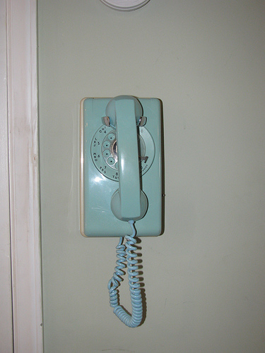 Are you a fan of soft colors? Then check out the pastel pop of this wall-mounted rotary phone. Kitschy and fun! Source:  Flickr User brokersaunder