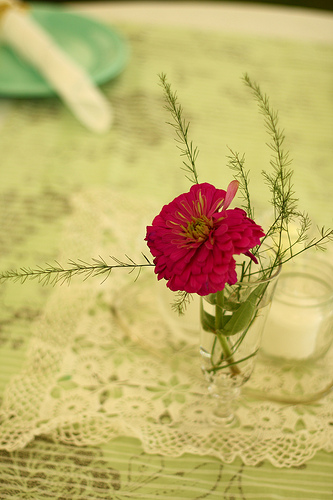 Garden flowers were displayed in tiny cups. I love the pink pop of this zinnia against the neutral linens.