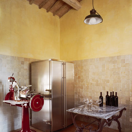 You can use yellow to give your kitchen a Tuscan effect with color washing. But to keep it from looking too faux, mix updated appliances, industrial accessories, and worn wood. Source