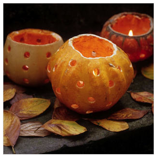 Lacking porch space? Then use mini pumpkins to create a collection of lanterns for your home.