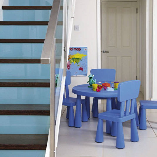 These stairs have been painted on the risers and then covered with toughened glass, to create a glossy finish.  Source