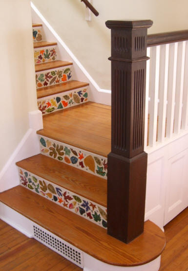 These custom leaf ceramic tiles create a Fall-like feel in this home. Use tiles to create pattern on your home's staircase.  Source