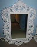 This Vintage 19-by-11 Shabby Chic Style Mirror ($58) has a girlish scroll pattern and has been updated with bright white paint.