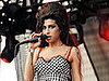 Amy Winehouse Won't Attend Grammys but Will Perform