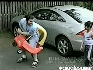 Guy Gets  Stuck in Toy Car