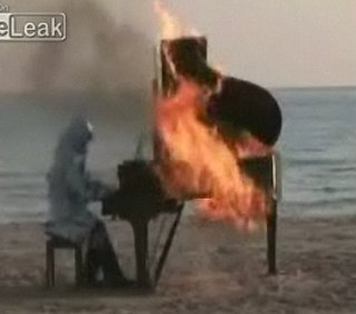 Man Plays Burning Piano