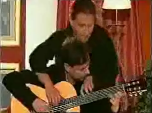 Two Men Play One Guitar