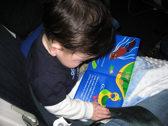 Reading on his first plane ride